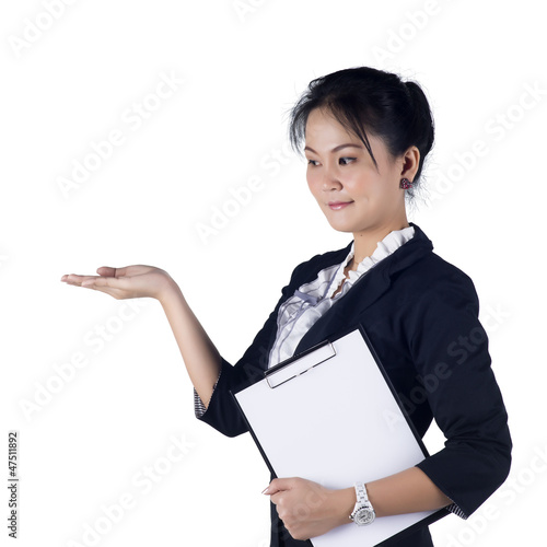 Happy smiling young business woman showing blank area for sign o
