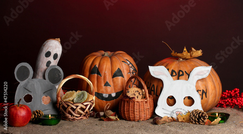 Trick or treat halloween masks and  buckets filled with cookies