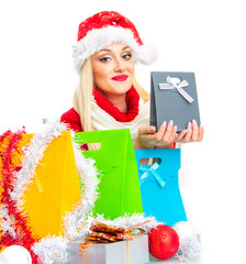 Happy santa claus woman holding gift, close-up
