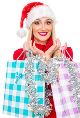 Happy christmas or santa claus woman with shopping bags - gift