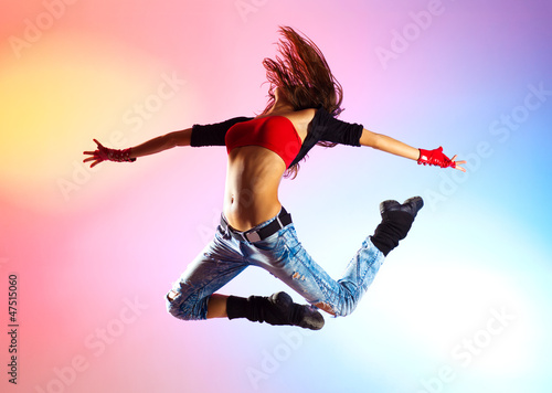 Young woman dancer jumping