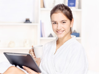 Woman in bathrobe relaxing at home