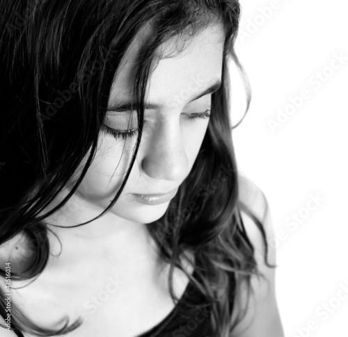 Black and white portrait of a sad hispanic girl