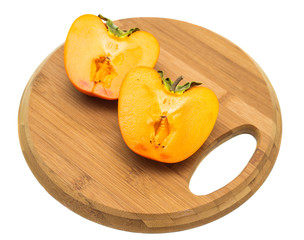 persimmon on a cutting board
