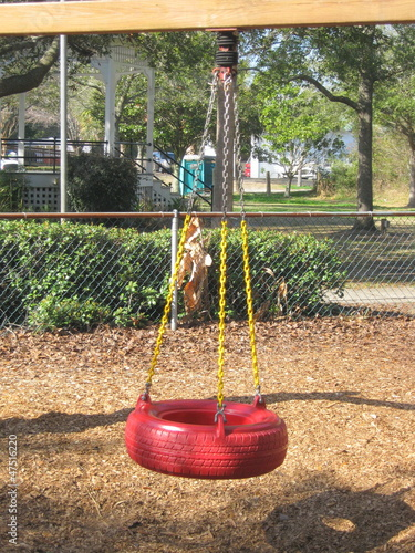 Red Swing In Park
