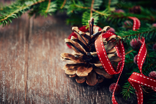 Rustic christmas decoration with spruce twigs and pine cone