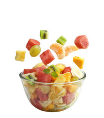 Fruits salad flies to the bowl isolated on white background