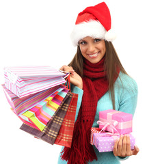 beautiful young woman with shopping bags and gifts, isolated