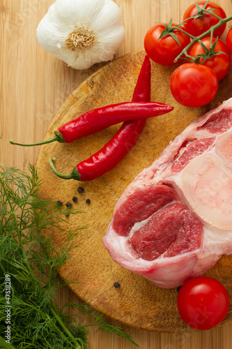 Raw oxtail with ingredients on cut board
