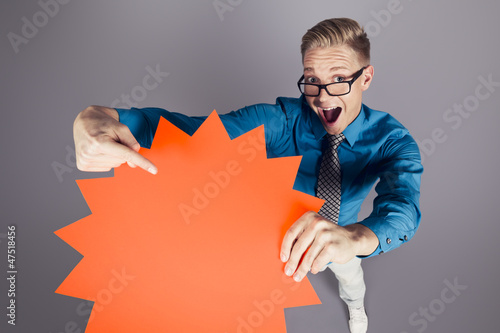 Enthusiastic salesman pointing at empty sign with space for text