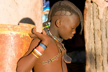 Himba boy with traditional hair style and jewelry