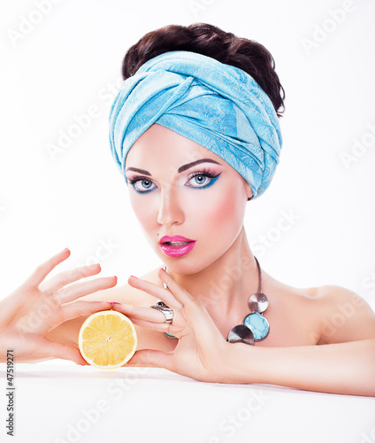 Tasty Woman Holding a Juicy Fruit - Diet and Calories concept