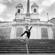 Young beautiful ballerina dancing on the Spanish Steps in Rome.