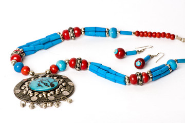 Antique colourful stone Necklace & earrings on white background