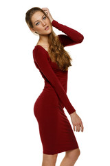 Sensual fashion model in red dress over white background