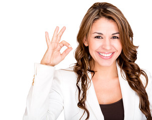 Businesswoman making an ok sign
