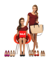 teenage girls with shoes, bag and sale sign