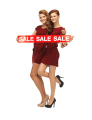 teenage girsl in red dresses with sale sign