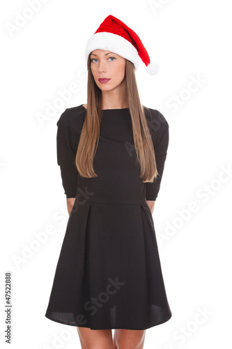 Woman in black dress wearing red Santa hat