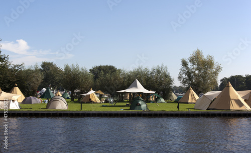 tipi tents on a dutch camping with blue sky