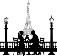 Romantic couple in front of Eiffel tower in Paris have a dinner