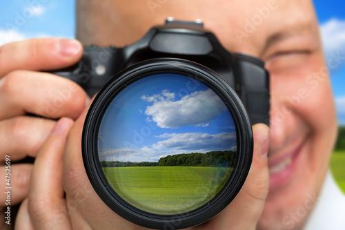 Photographer capturing rural landscape