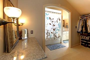 Large closet  room with door to bathroom.