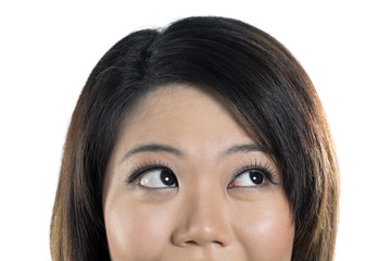 Closeup of beautiful Chinese woman looking up.