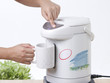 Pouring hot drinking from electric water boiler pot
