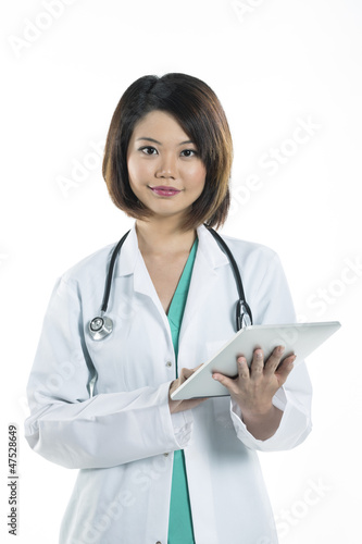 Chinese doctor holding a digital tablet
