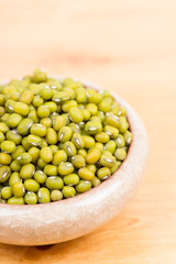 Green mung beans in bowl on the table