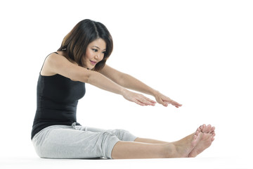 Beautiful Chinese woman stretching before exercise