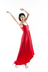 Happy Chinese woman wearing red summer dress