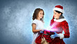 Little girl with christmas gifts and santa