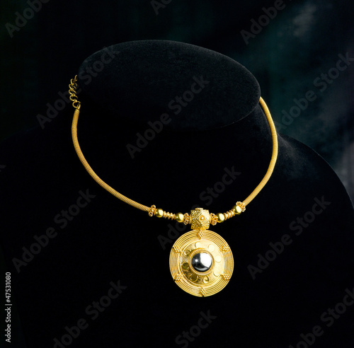 Luxury golden necklace and pendant in Thai ancient style