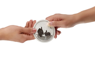 Woman holding silver coin