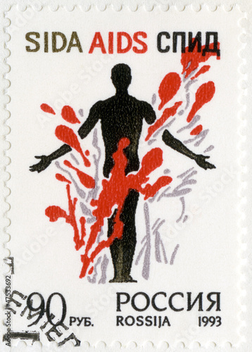 RUSSIA - 1993: shows Stop AIDS! A man's figure in a colorful com