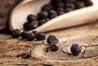 Black pepper on the rustic old wooden table