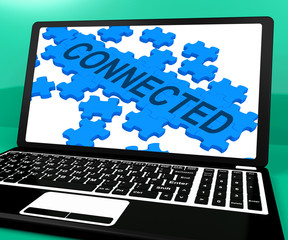 Connected Puzzle On Notebook Showing Online Communities
