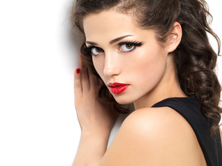 Beautiul fashion girl with red manicure and lips