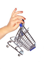 Shopping discount concept: Woman's hand holding a shopping cart