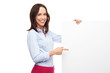 Businesswoman pointing at blank poster