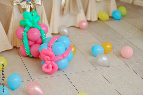 festive decoration of colored balloons and pieces of them