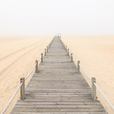 Wooden footbridge on a foggy sand beach background. Portugal. - 47540889