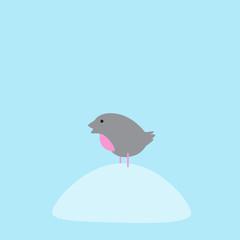 Bullfinch sitting on snowdrift