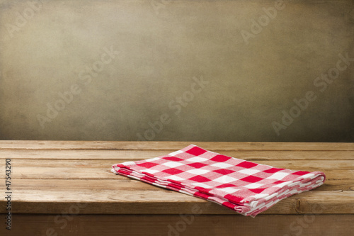 Background with tablecloth and wooden deck table