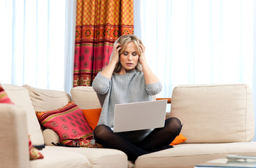 attractive woman with laptop and headache