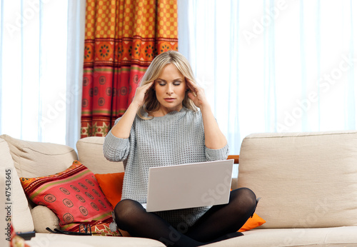 attractive woman with laptop having migraine