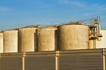 Wine vats over blue sky