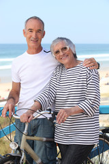 senior man and senior woman at the beach